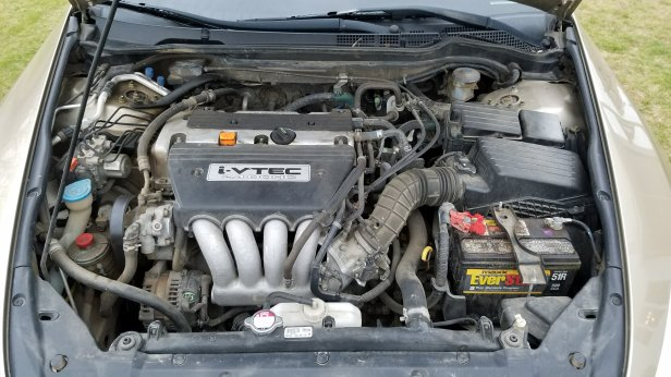 The engine bay of a 2004 Honda Accord