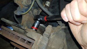 011-sienna-removing-caliper-bracket-bolt