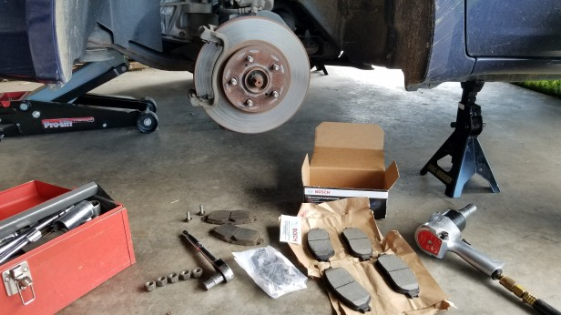 017-old-brake-pads-removed-with-new-brake-pads