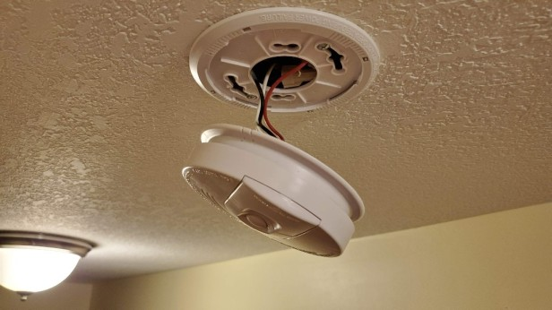 smoke-alarm-dangling-from-wire-harness