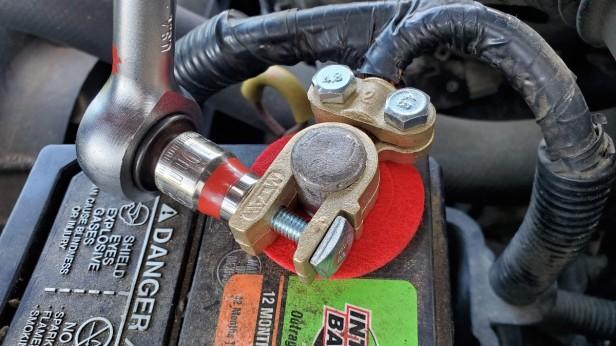 15-tighten-positive-battery-terminal-cable-clamp