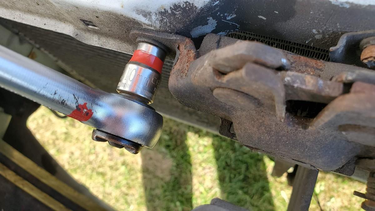 07-remove-10mm-bolts-hood-latch-Toyota-Corolla