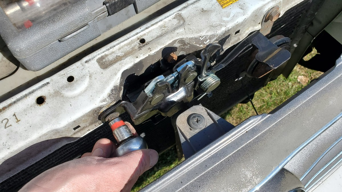 11-install-new-hood-latch-mechanism-Toyota-Corolla