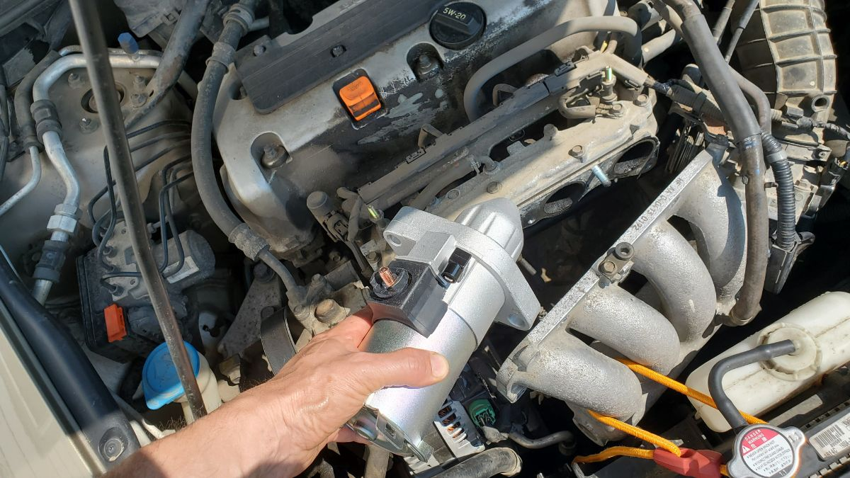 Install the new starter into a Honda Accord