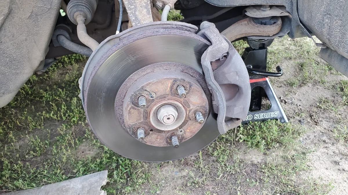 Wheel Removed from Honda Accord showing brake rotor and caliper