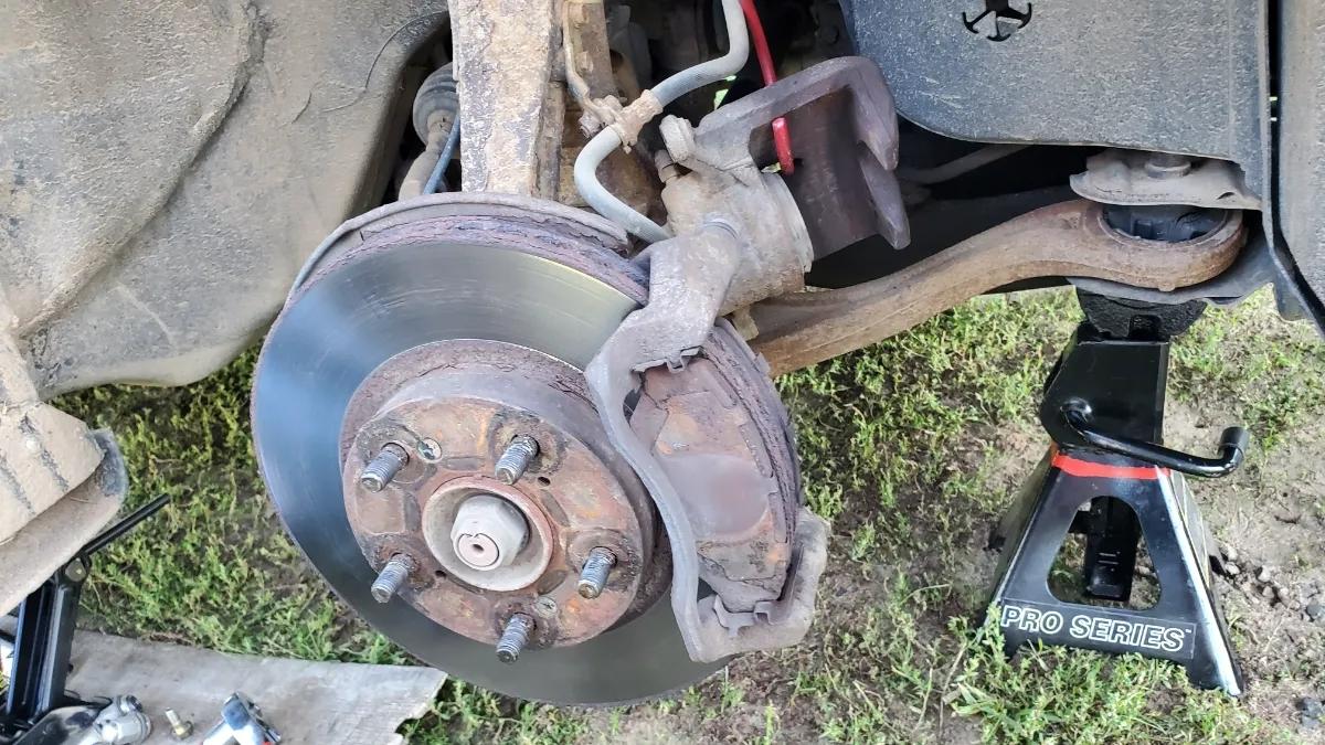 Honda Accord Caliper removed exposing brake pads