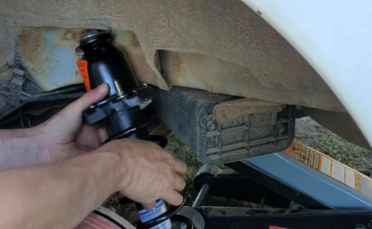 Install the new Strut Toyota Corolla