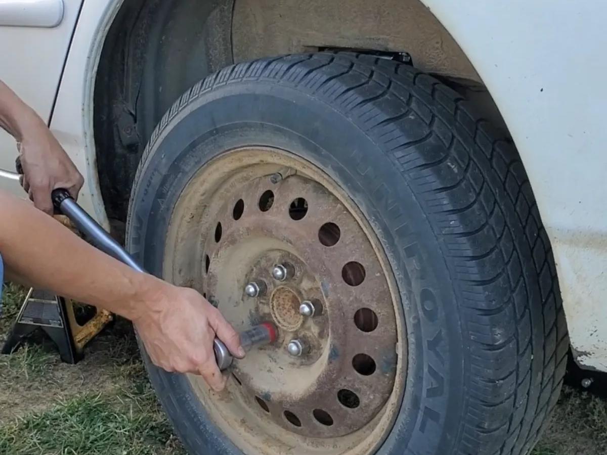 Reinstall tire  Toyota Corolla Rear Strut Replacement
